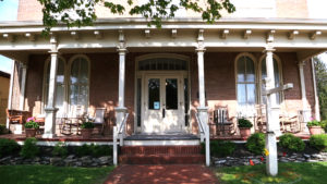 Relax on the front porch of the Kintner House Inn